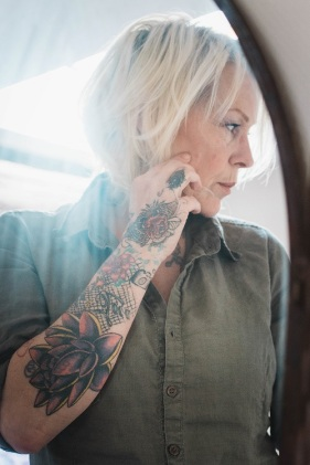 older tattooed woman