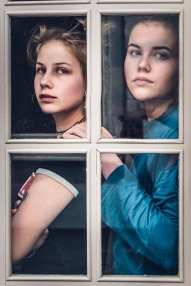 two girls through window