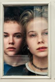two girls through window